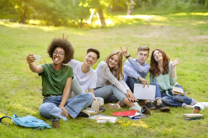 Selfie Fun. Group Of Multiracial Students Fooling While Taking Group Photo Outdoors