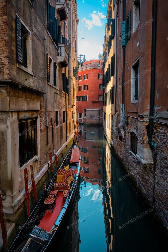 Narrow canal with gondola in Venice, Italy