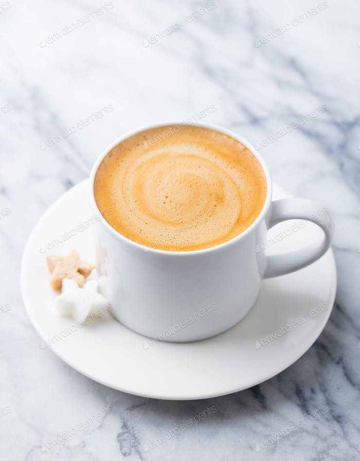 Coffee, Espresso in White Cup of Marble Table Background.