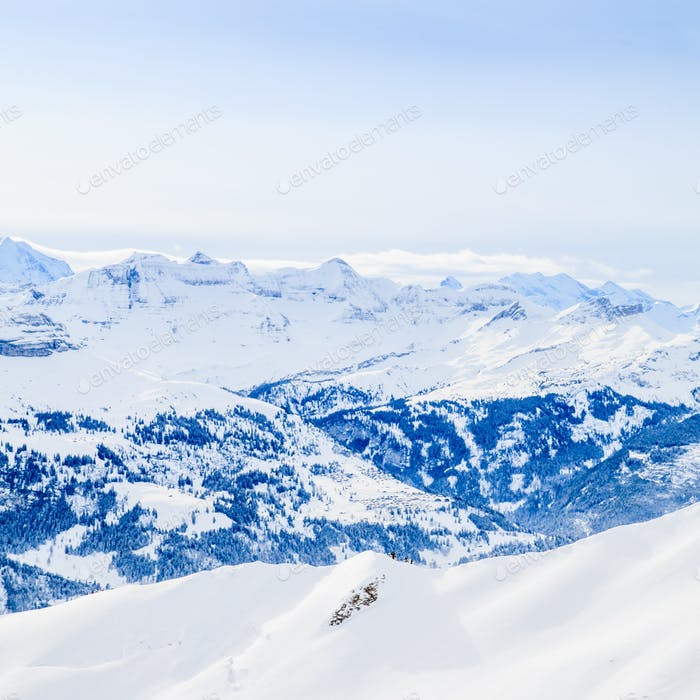 Winter snow covered mountain peaks in Europe. The Alps winter mo