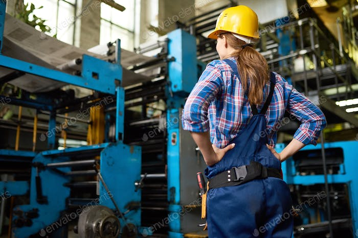 Female Factory Worker Supervising Quality in Workshop