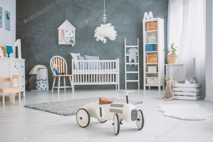 Spacious baby room with cot