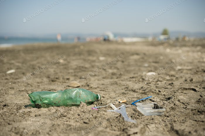 Plastic garbage left on a sandy beach.