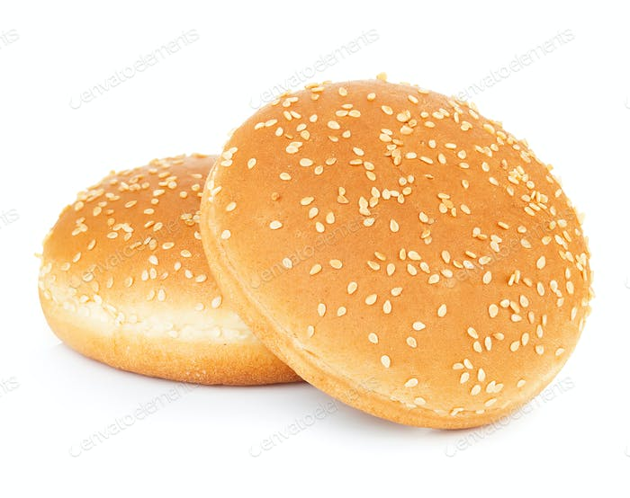 Two sandwich bun with sesame seeds isolated on white background.