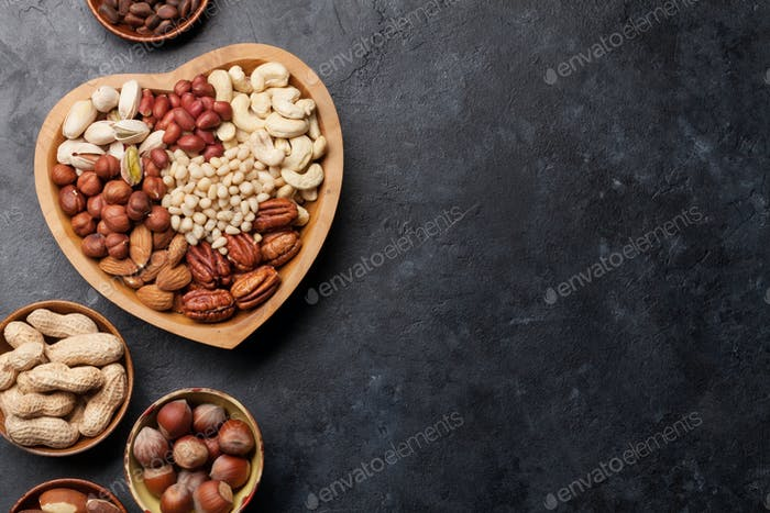 Various nuts selection on stone table
