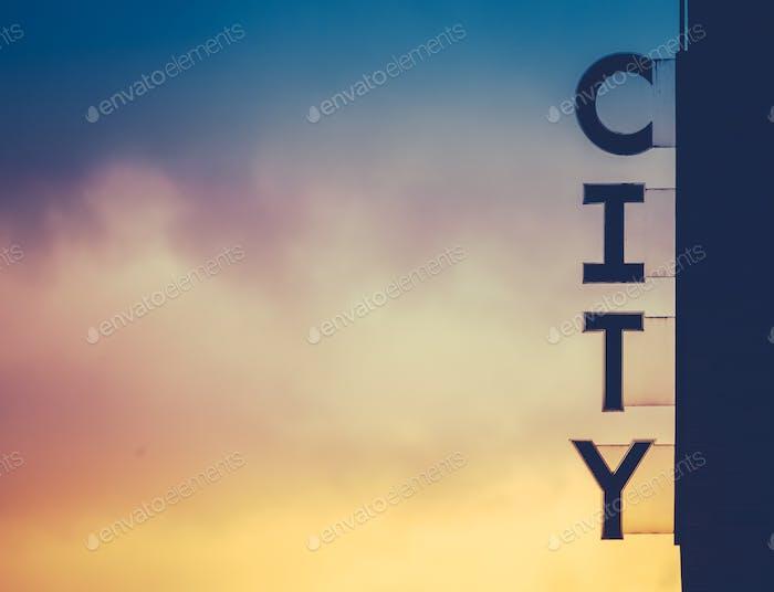 Urban City Sign At Sunset