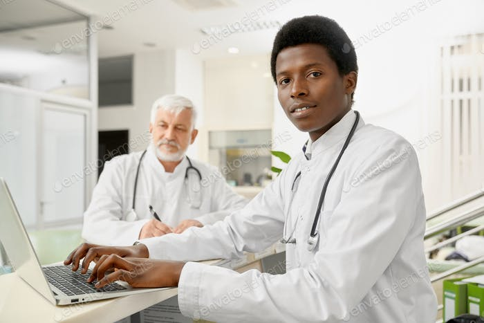 Multicultural doctors on reception
