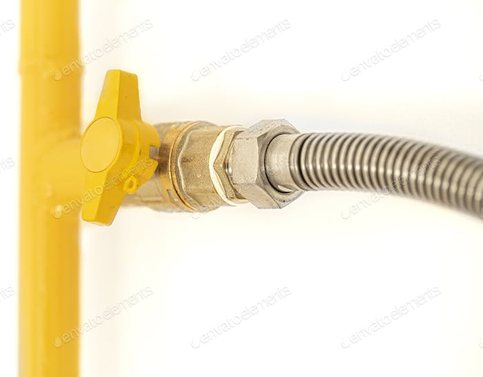 Yellow gas pipe with a valve. White background.