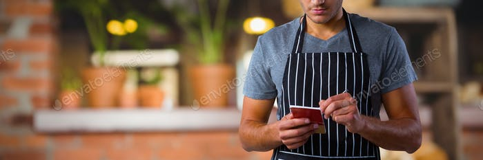 Composite image of male waiter taking order