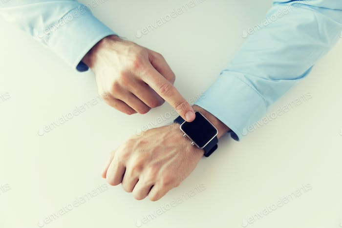 close up of male hands setting smart watch