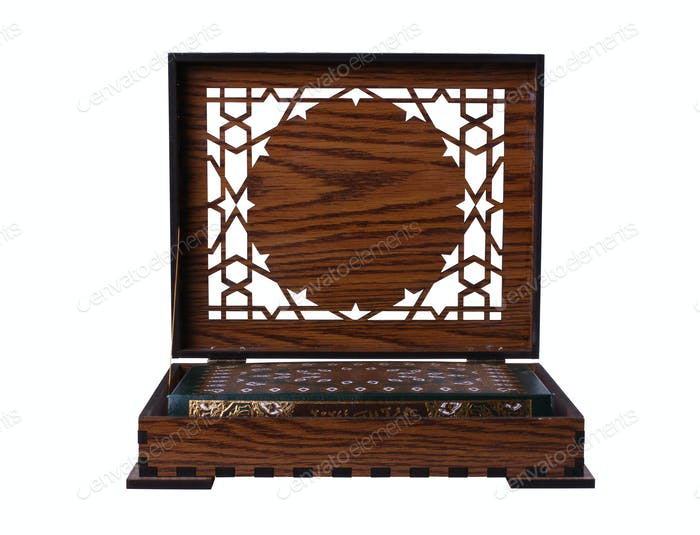 Qur'an in a wooden box isolated.