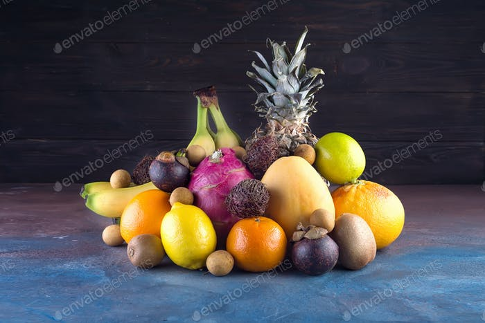 Assorted tropical fruits, orange,Ananas or pineapple, lime,mango, dragon fruit, orange, banan