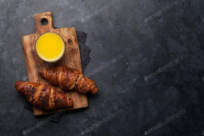 Orange juice and croissant