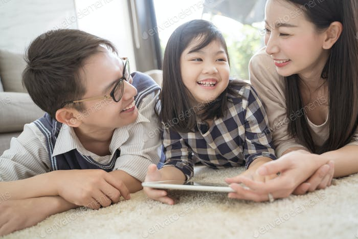 Asian family spending time together in living room. family and home