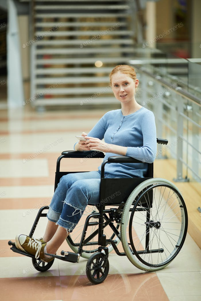 Disabled woman using mobile phone