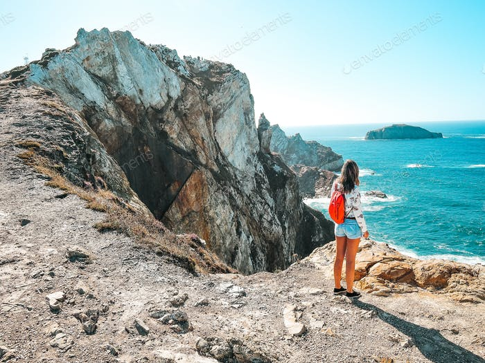 Young woman contemplating the cliffs in Asturias, Spain