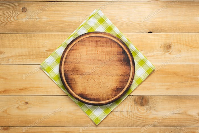 pizza cutting board at rustic wooden background