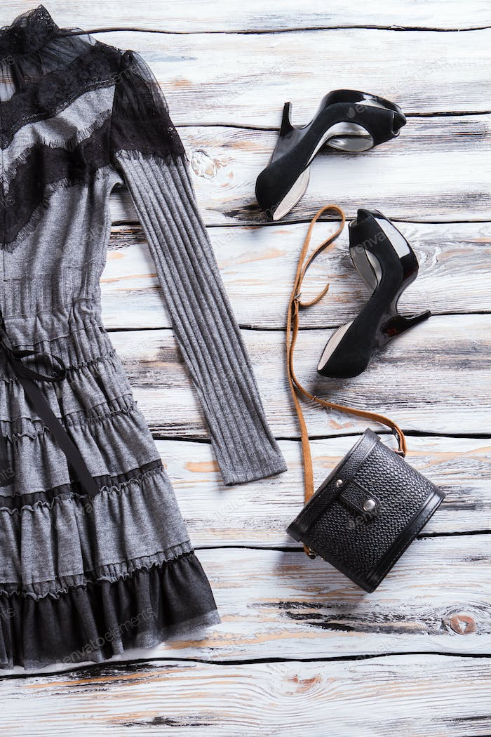 Gray dress and black bag.