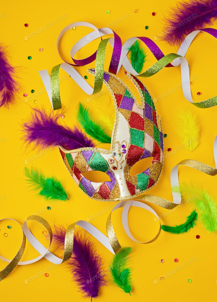 Festive, colorful mardi gras or carnivale mask and accessories