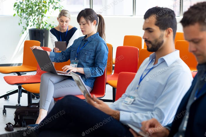 Businesswoman using laptop in a office