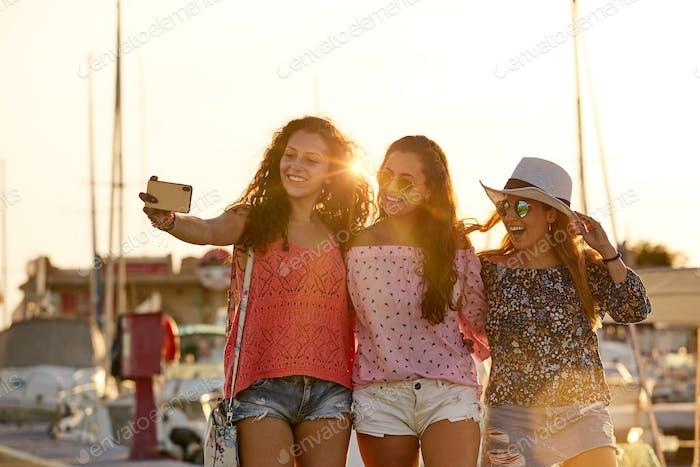 Optimistic fellows bonding and shooting selfie in summer