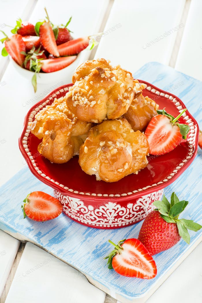 Profiteroles with nuts and strawberries