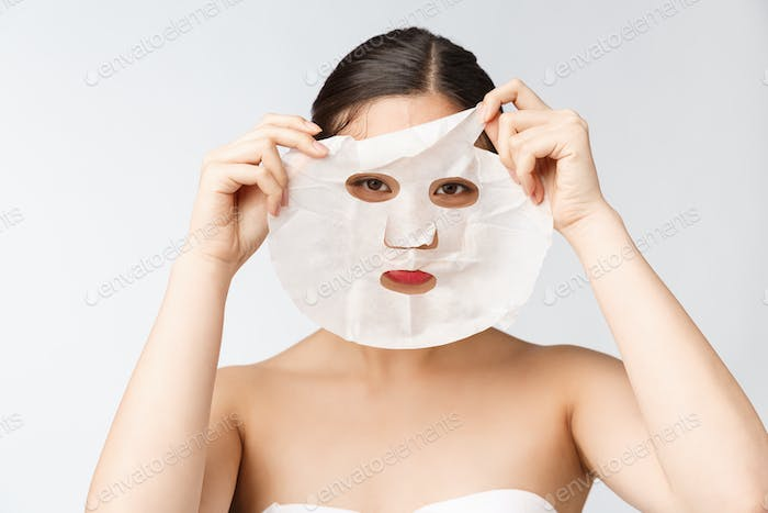 Spa, healthcare. Woman with purifying mask on her face isolated on white background