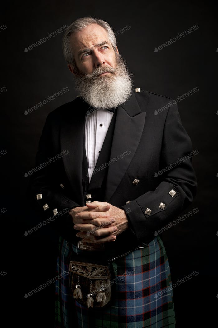 mature male model wearing kilt with grey hairstyle and beard