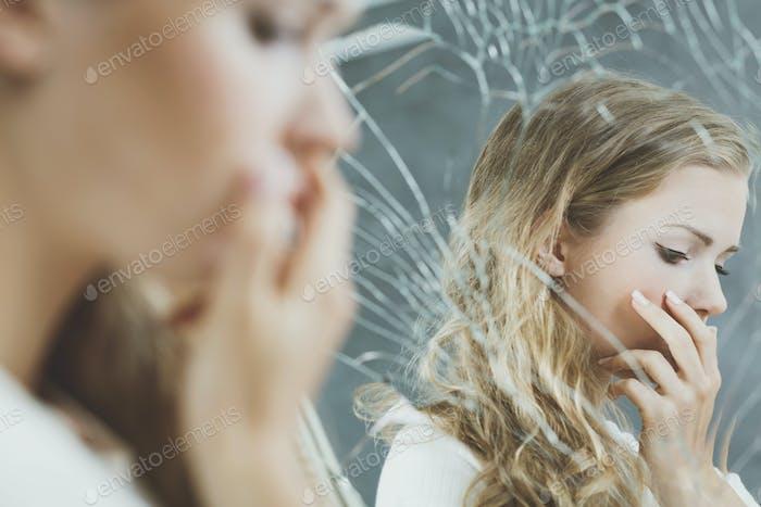 Girl and the broken mirror