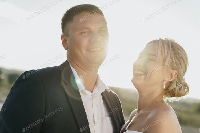 Portrait of a bride and groom in a sunset light