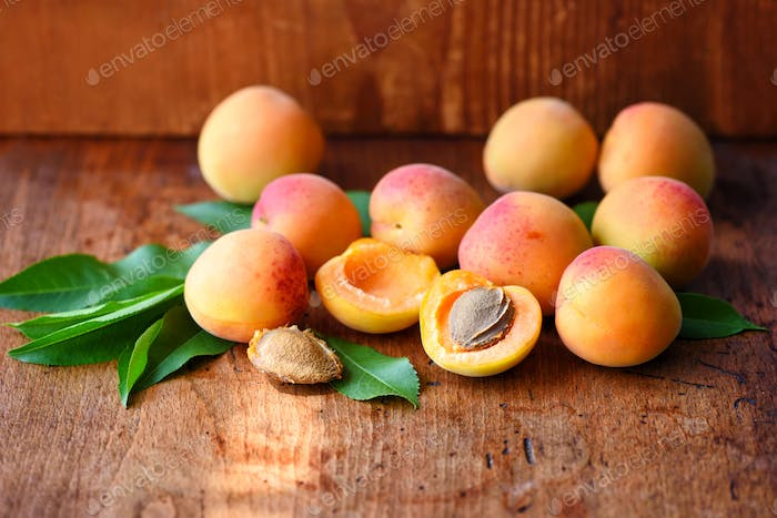 Ripe apricots on the old wooden background