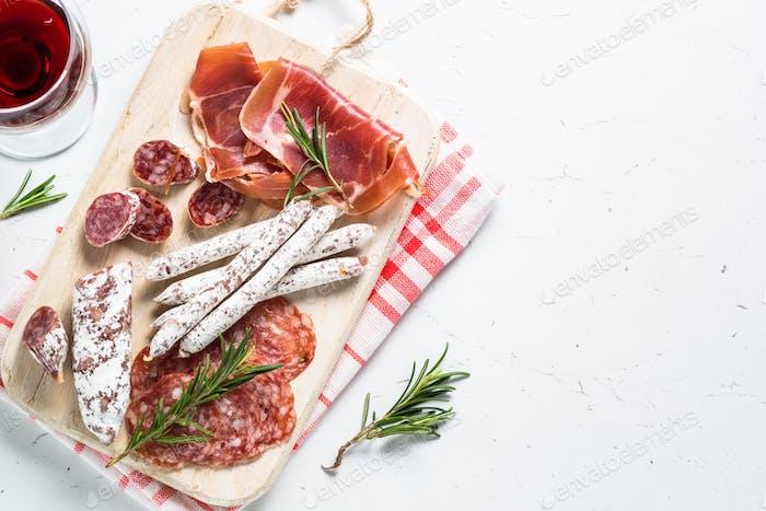 Antipasto set of meat snack on white