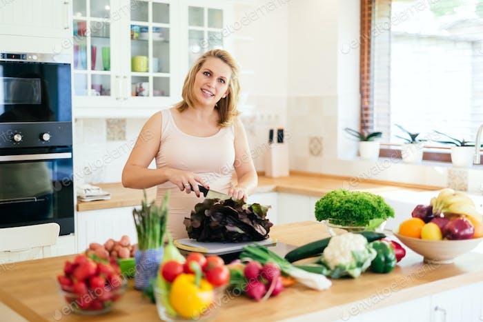 Woman preparing meal on kitchen island