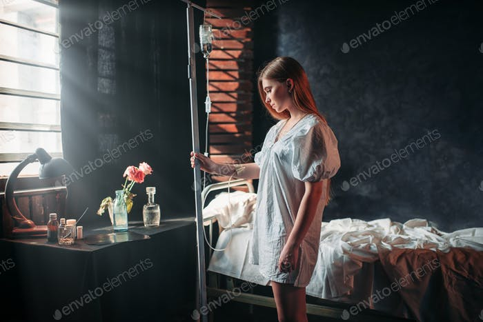 Young sick woman is on drip in hospital
