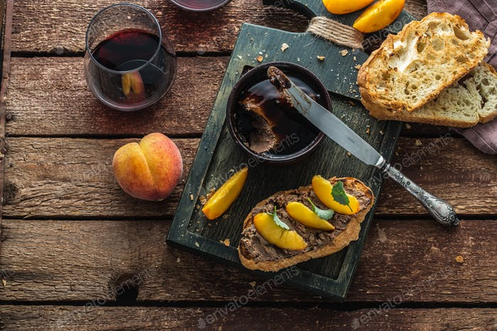Liver pate with griiled bread and peach, rustic style