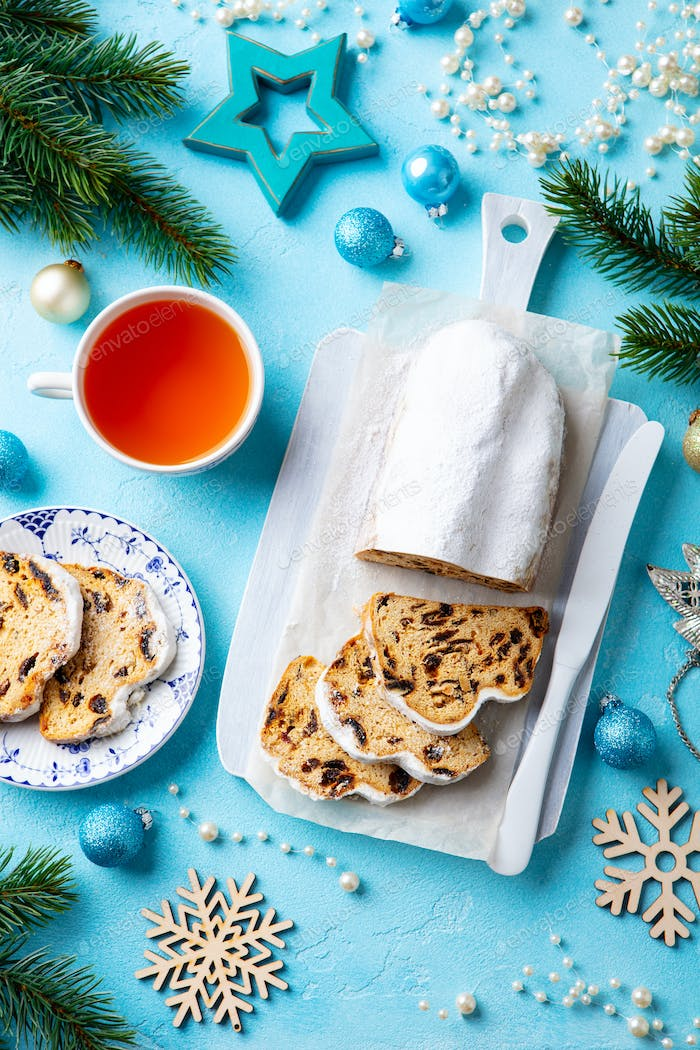 Christmas Stollen Cake with Icing Sugar, Marzipan and Raisins.
