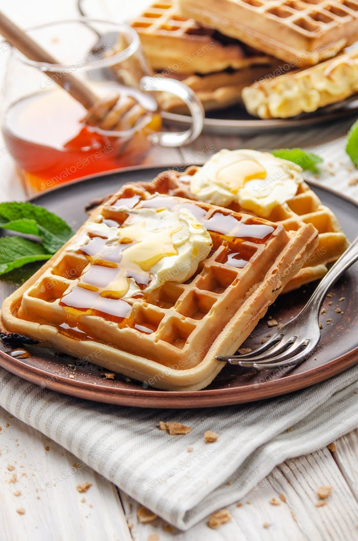 Belgian waffles served with butter and honey