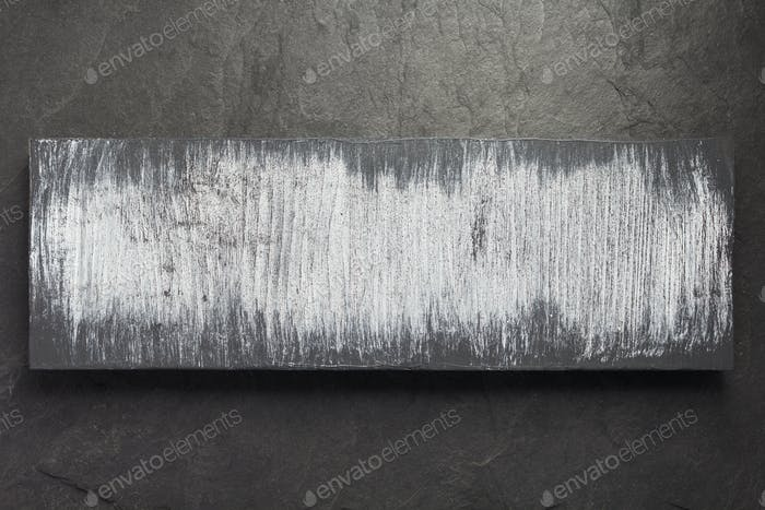 wooden plank board on slate stone background