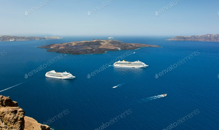 cruise ship near volcano on island of Santorini