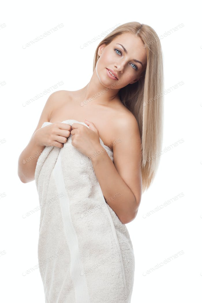Beautiful girl standing in towel