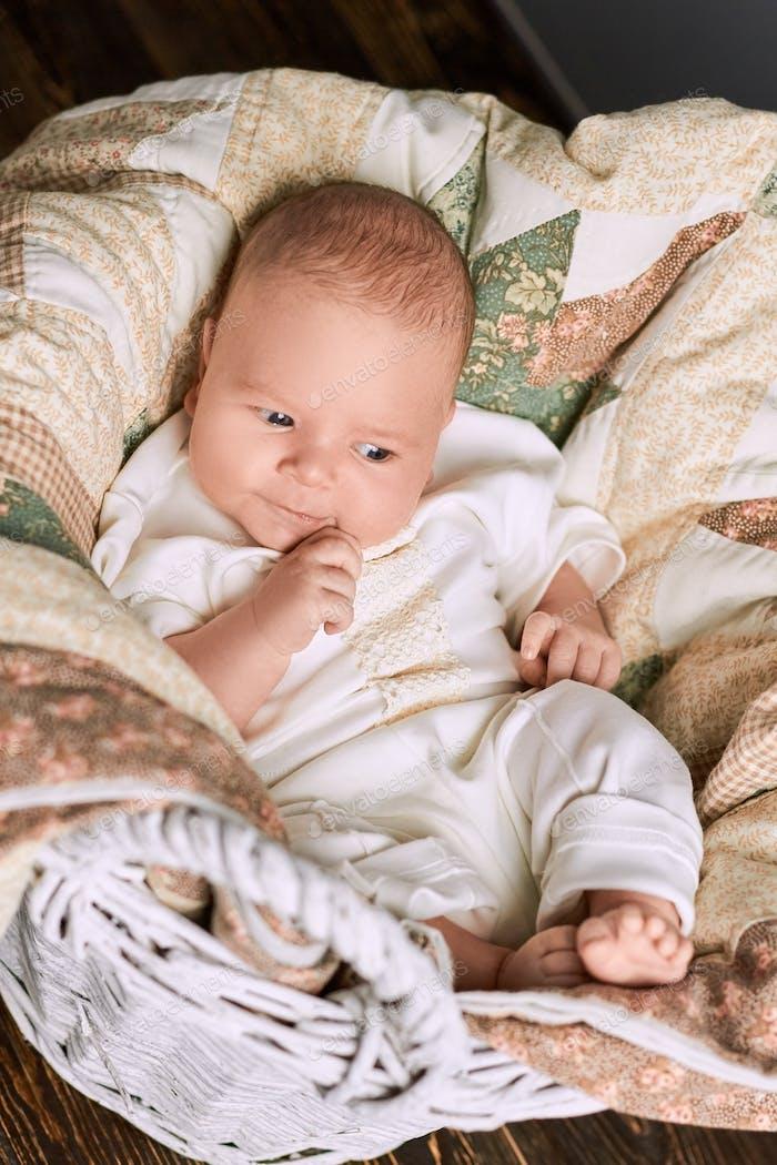 Thoughtful caucasian baby