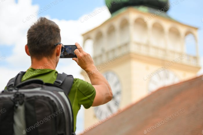 Tourist Taking Travel Pictures Using His Smartphone