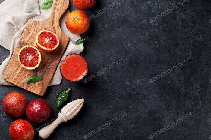 Fresh citruses and red orange juice