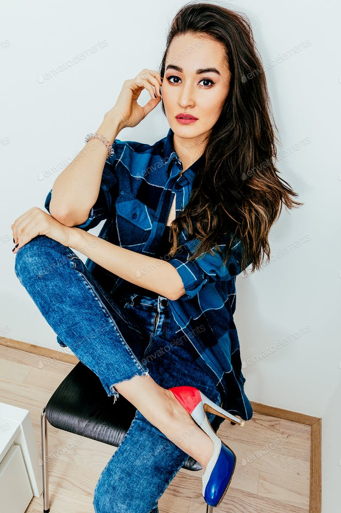 Beautiful Lady with long hair in checkered shirt. Casual look