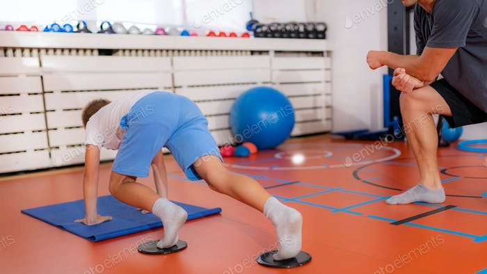 Child doing mountain climbers for better core and abdominal muscle strength