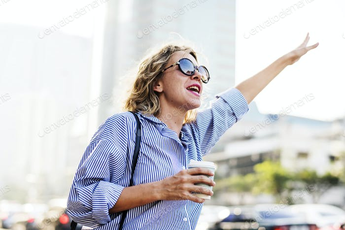 Woman wave for a cab