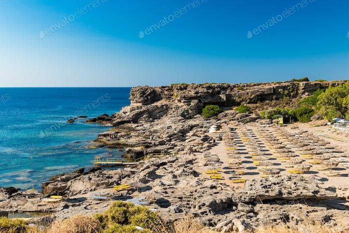 Kallithea Beach at Mediterranean Sea and Cliffs, Rhodes, Greece