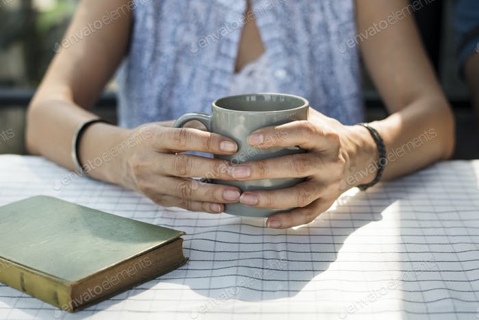 Woman having a mug of hot coffee