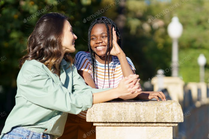 Two Multiethnic women talking together on the street