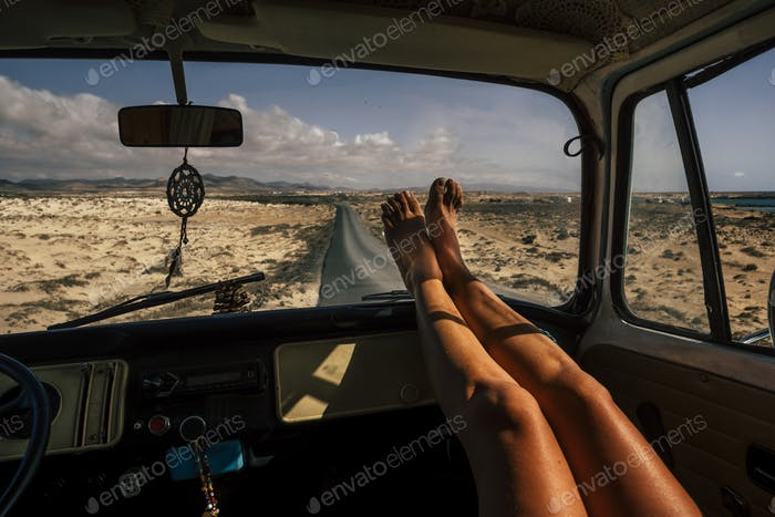 Travel and freedom concept people with close up of woman legs enjoy the road trip